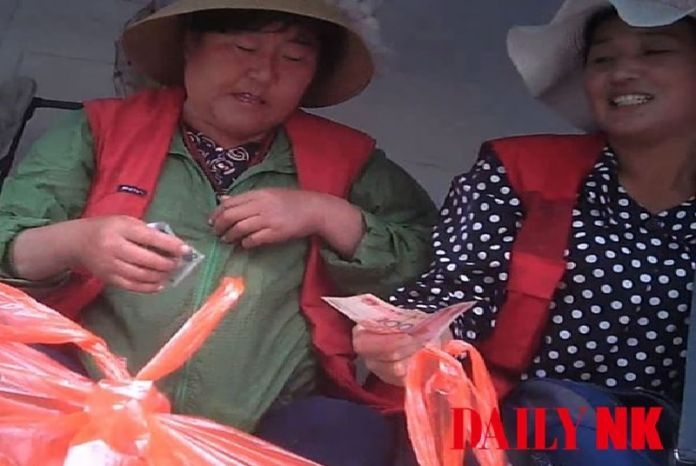 Traders selling seafood at an official marketplace in North Korea's Rason City