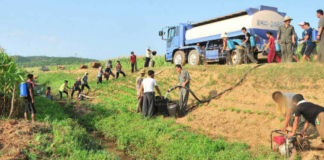 North Korean farmers in August 2018 in North Hwanghae Province attempt to prevent drought damage