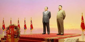 Statues of Kim Il Sung and Kim Jong Il inside the Kumsusan Palace of the Su