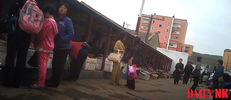Vendors and customers at Rason Market in North Hamgyong Province