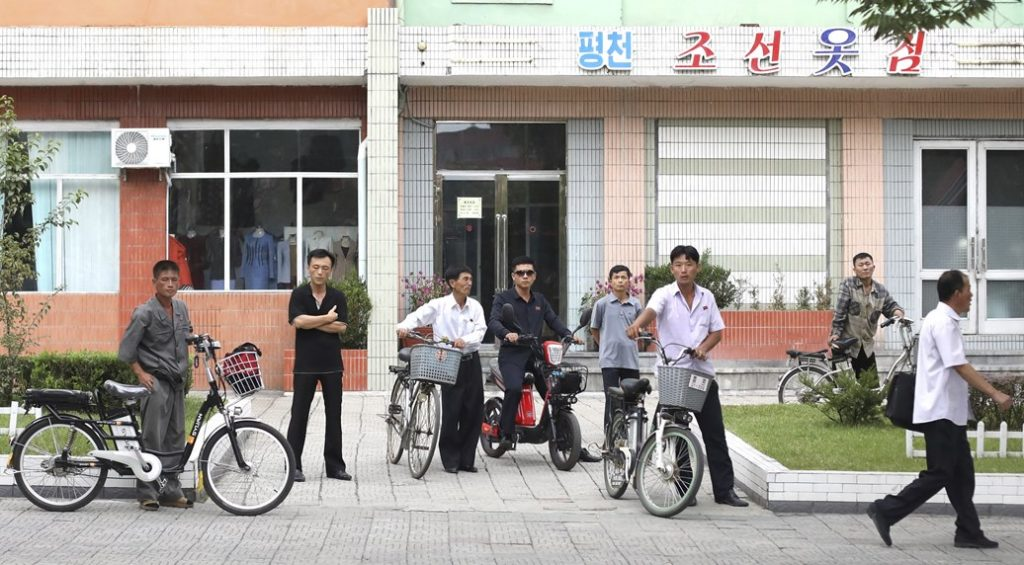 Pyongyangites with electric bikes and scooters