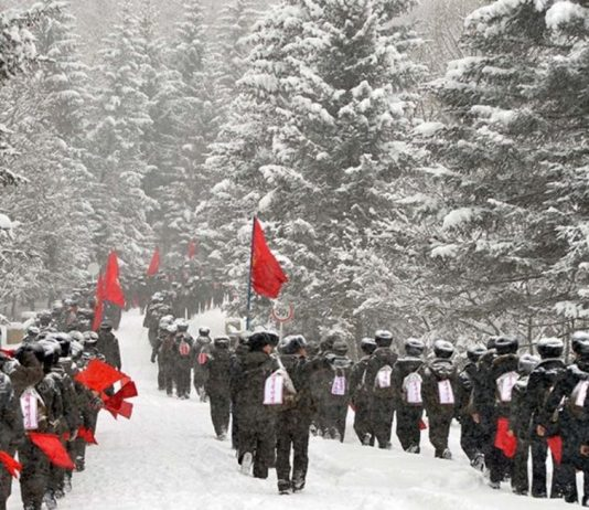 Youth League marching on February 1 to Mount Paektu near Milyong,
