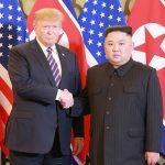 U.S. President Donald Trump and North Korean leader Kim Jong Un shake hands during the Hanoi Summit last mont