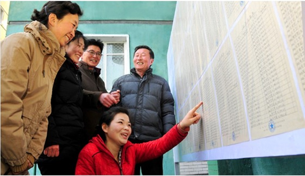 North Koreans checking the list of candidates for the 2019 Supreme People's Assembly election