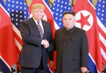 U.S. President Donald Trump and North Korean leader Kim Jong Un shake hands during the Hanoi Summit last month human rights agenda sanctions