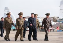 Kim Jong Un visits air force unit in this photo released by KCNA on April 17.
