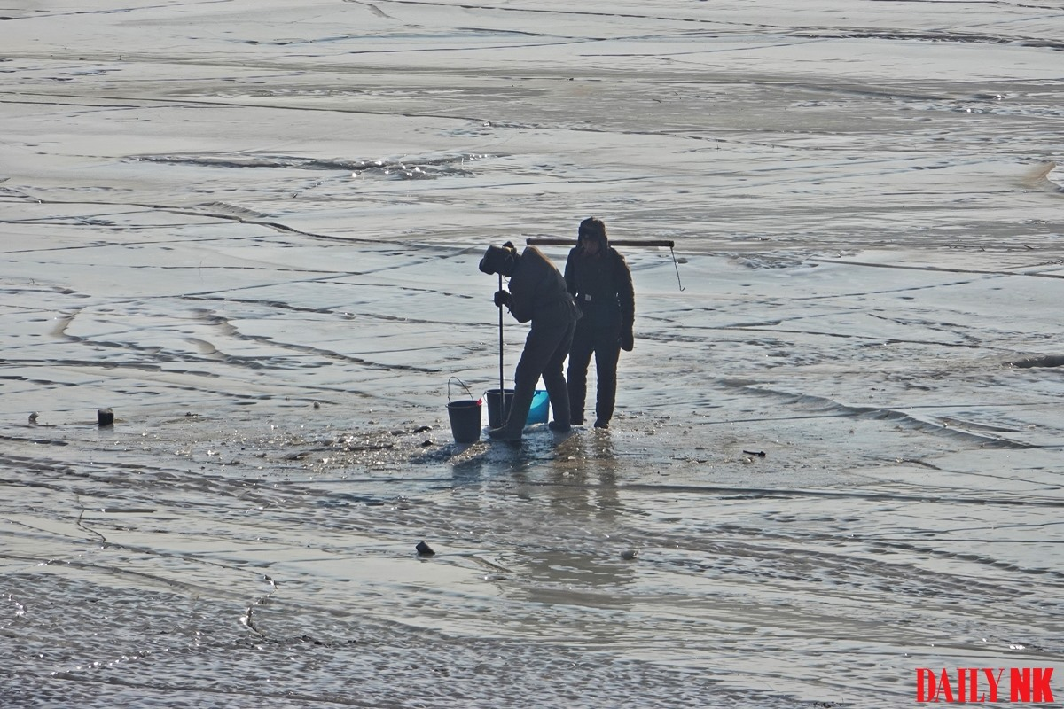 In this photo from February 2019, North Korean border guards ice fishing in Onsong County, North Hamgyong Province. Taken in February 2019