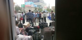 North Korean laborers in Dandong waiting en route back to North Korea
