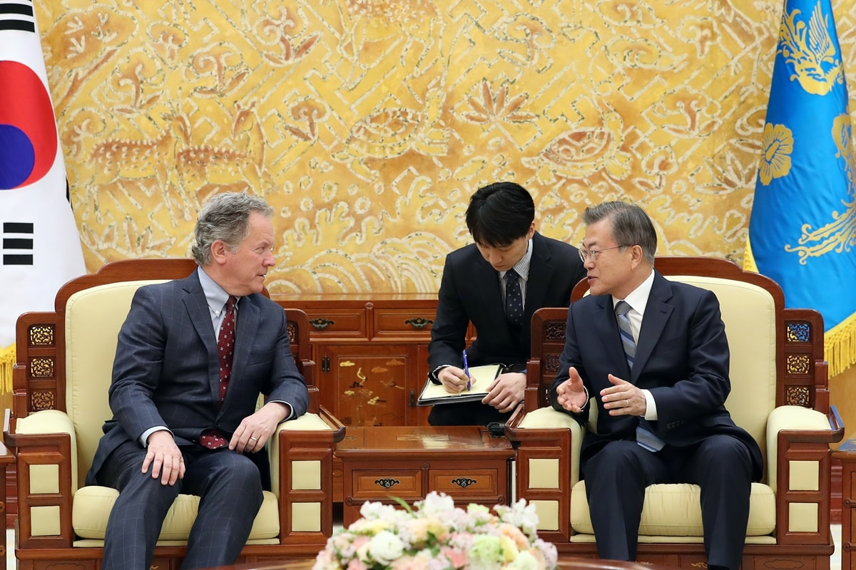 South Korean President Moon Jae In talks with World Food Programme Executive Director David Beasley at the Blue House on May 13