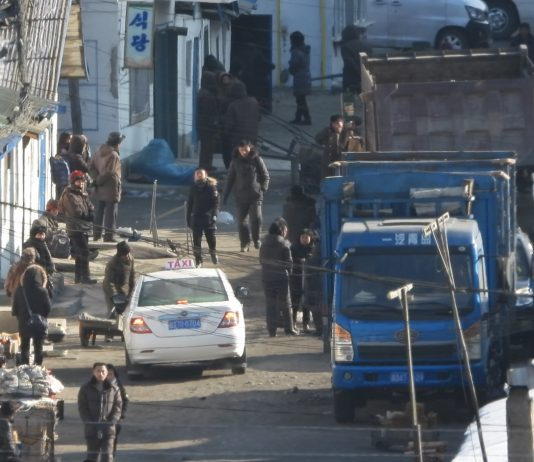North Koreans sell goods on the street in the North Korea-China border region