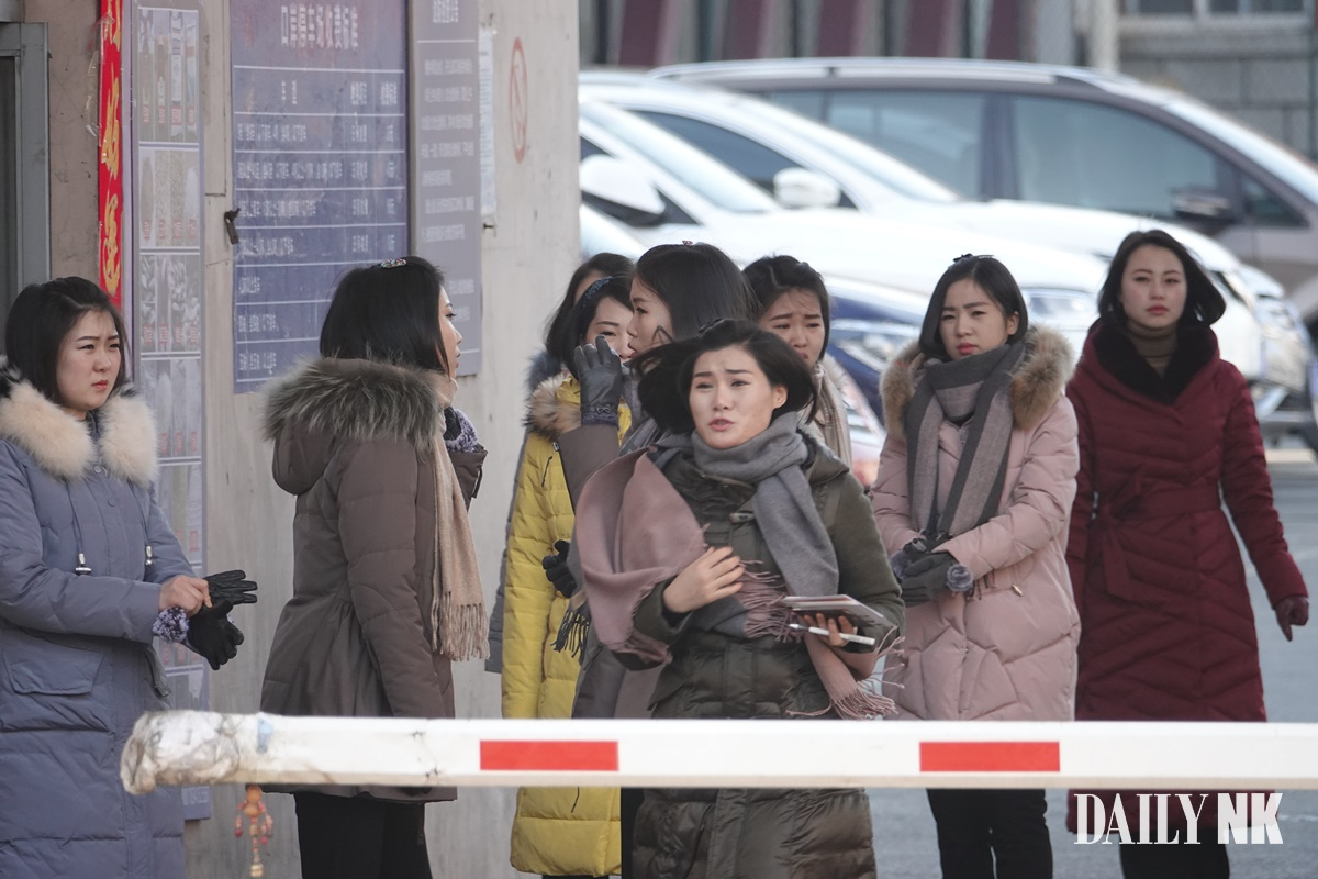 North Korean women exit the customs office in Dandong. Taken in February 2019