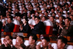 Kim Jong Un and his wife Ri Sol Ju watch an art performance given by the wives of military officers in Pyongyang on June 2, 2019