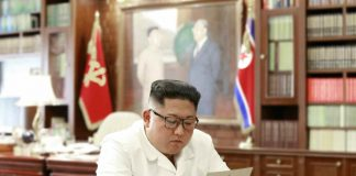 North Korean leader Kim Jong Un reads a letter from U.S. President Donald Trump