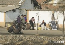 Merchants well grain and solar panels in Sunchon, South Pyongan Province