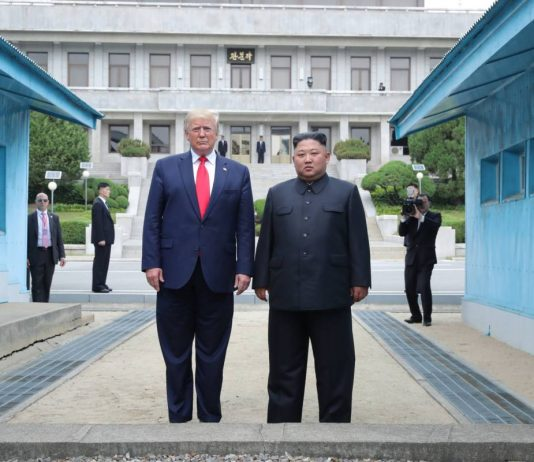 President Donald Trump and North Korean leader Kim Jong Un stand on the North Korean side of the DMZ in Panmujom on June 30