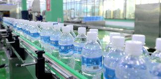 Drinking water produced at a factory near North Korea's Ryongak Mountain. Image = Uriminzokkiri homepage