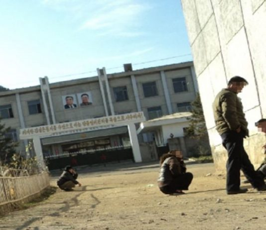 Residents wait to see detained family members at a Ministry of State Security office in a border region of North Korea