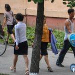 Male North Korean resident pushing a stroller in Pyongyang
