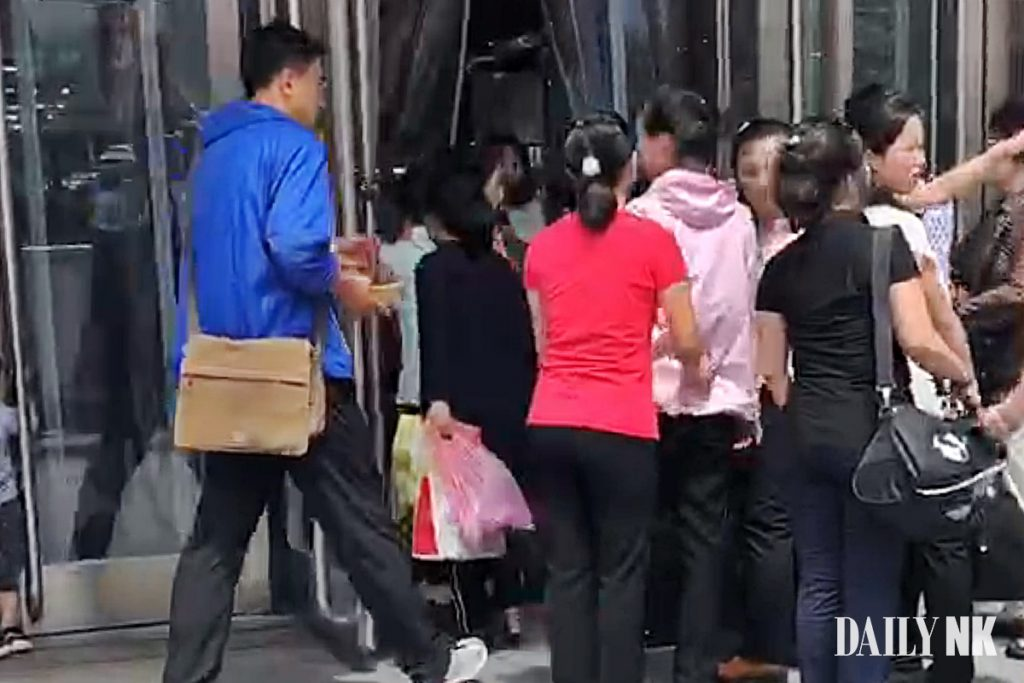 North Korean workers entering a store in Dandong, China