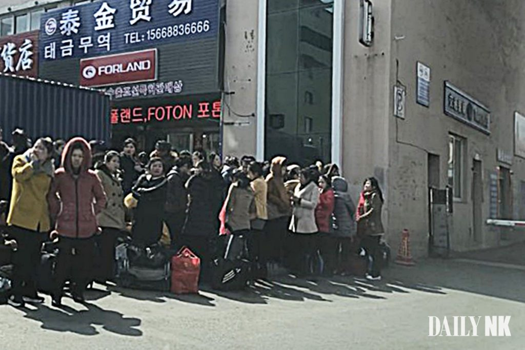 North Korean workers returning to North Korea via the customs office in Dandong in March 2019