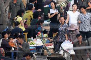 Street market in Hyesan, Ryanggang Province rice sellers dollar rate