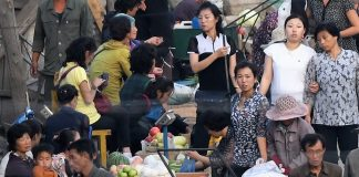 Street market in Hyesan, Ryanggang Province rice sellers dollar rate
