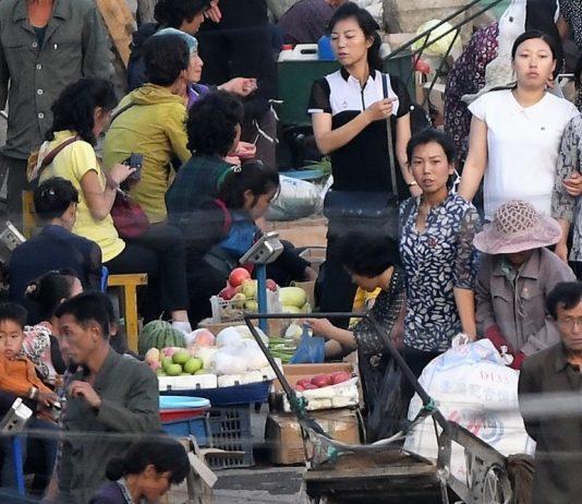 Street market in Hyesan, Ryanggang Province rice sellers