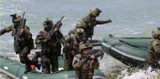 flood-ravaged soldiers