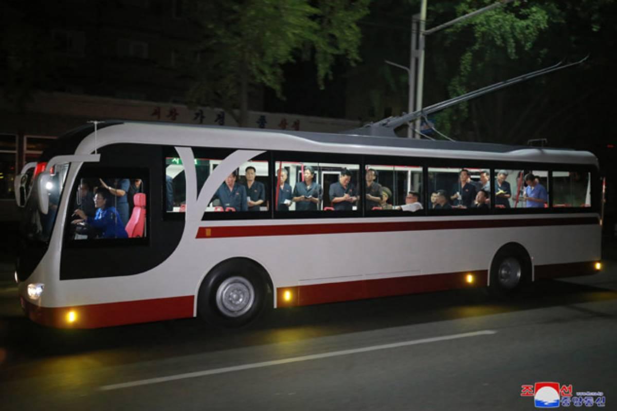 Kim Jong Un on new trolley bus in August 2018
