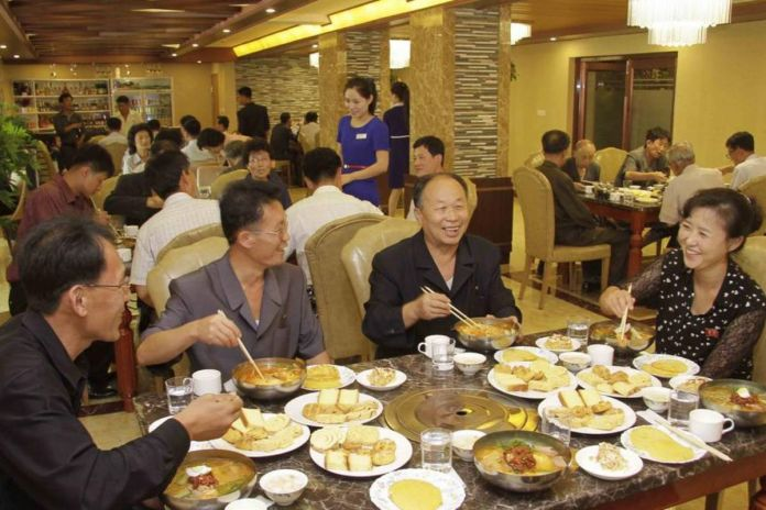 North Koreans residents enjoying corn noodles